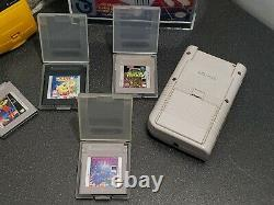 Lot of 4 Nintendo GameBoy Console Systems, games, 1 Factory Box and display case